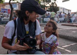 woman photojournalist with girl